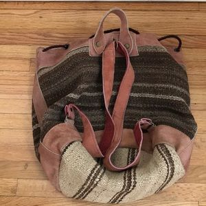 Vintage Bohemian rug and suede bucket backpack